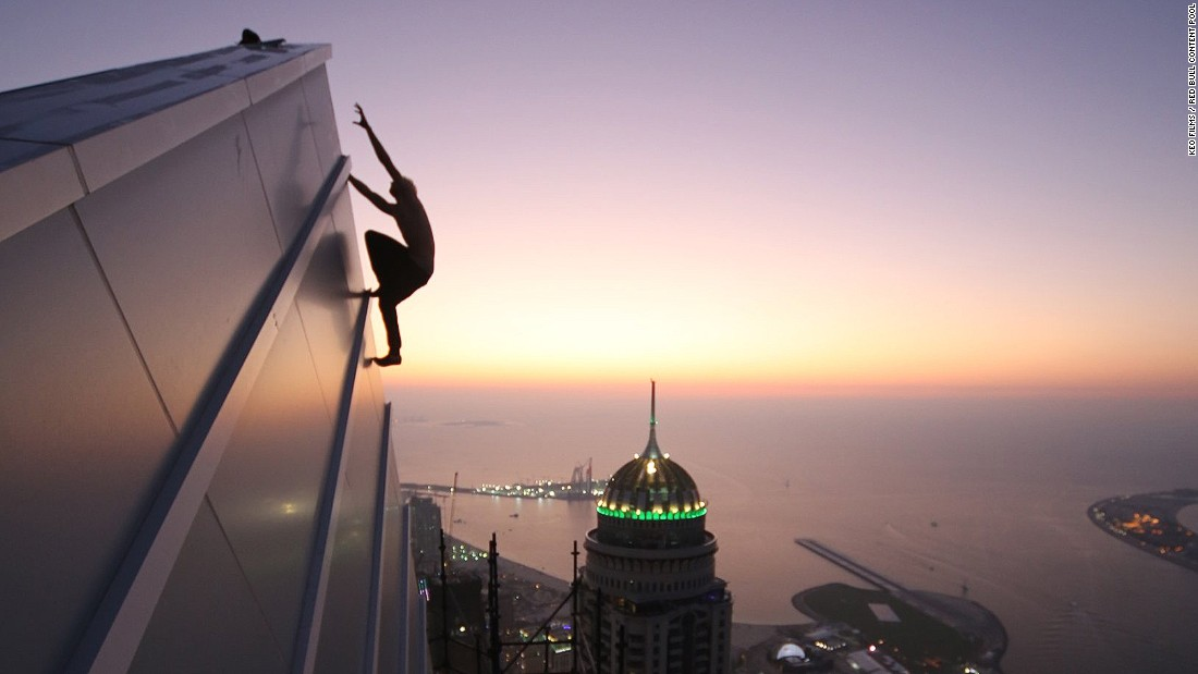 Urban climber Oleg Cricket in action in Dubai, December 2015. Not all urban climbing activity in the city is legal, but Dubai's many skyscrapers have proved tempting for practitioners